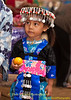 Young Hmong Girl in Traditional Clothing With An Orange at New Year's Festival in Luang Prabang, Lao People's Democratic Republic