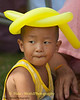 Young Lao Loum Boy With Balloon Hat