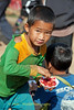 Akha Boy Enjoying A Shaved Ice Treat At the Xieng Kok Market, Laos