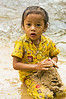 Girl Making Mud Castle in River - Phnom <br /> Kulen, Cambodia