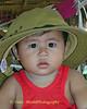 Kwan Wearing A Large Hat