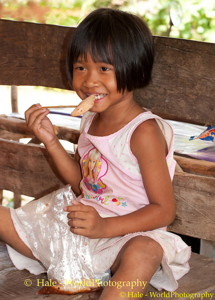 Mai of Tahsang Village in Udon Thani Province, Thailand  Enjoying An Afternoon Snack
