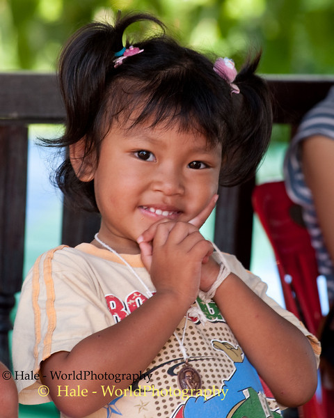 Young Lao Loum Girl Giving a Wai - sign of respect