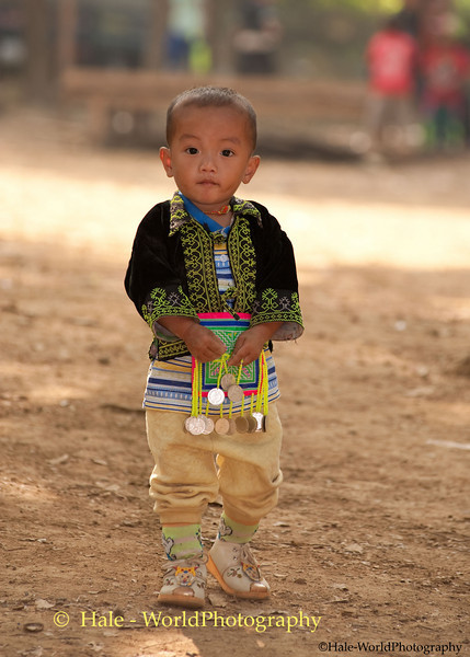 Young Hmong Boy in Traditional Clothing Holding A Ball at New Year's Festival in Luang Prabang, Lao People's Democratic Republic
