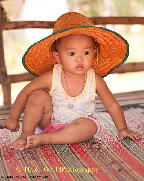 Young Boy With Big Straw Hat