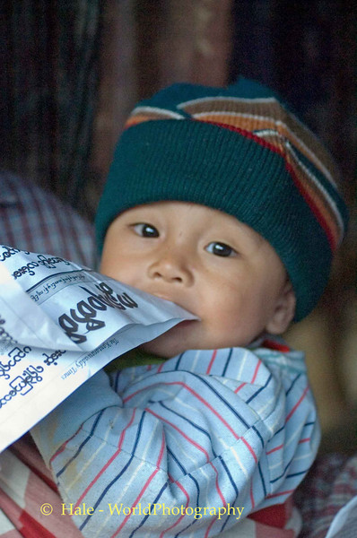 Hill Tribe Baby Chewing on Newspaper, Pai Thailand