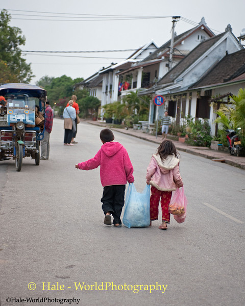 Brother and Sister return Home With Surplus Food Offerings From Monks in Luang Prabang, Laos