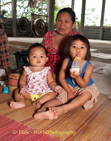 Granddaughters and Grandmother During Buddhist Merit Making Ritual