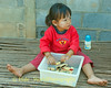 Lao Loum Child Guarding Her Christmas Cookies