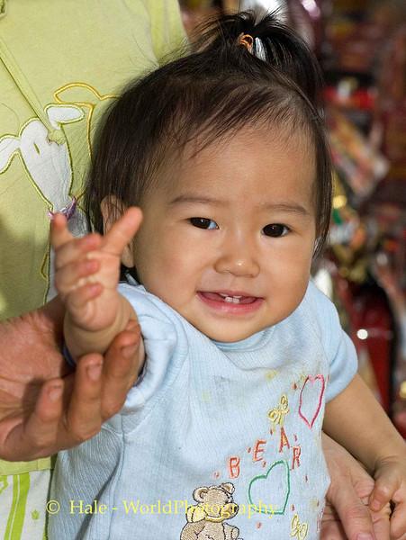 Friendly Toddler In Shop Child, Hanoi Vietnam
