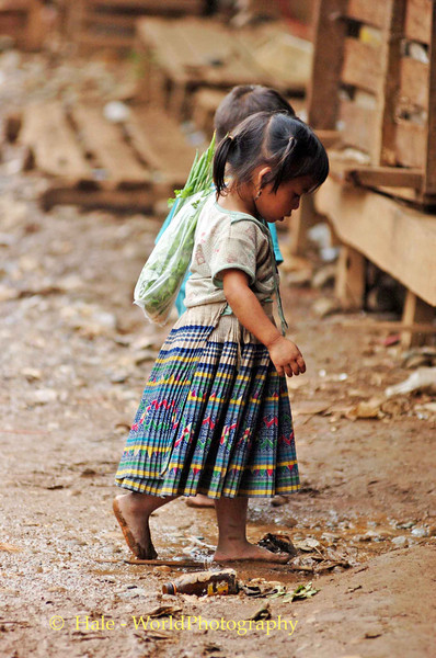Young Lao Girl Returning Home from Market