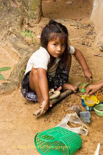 Girl Making Mud Pies - Phnom <br /> Kulen, Cambodia