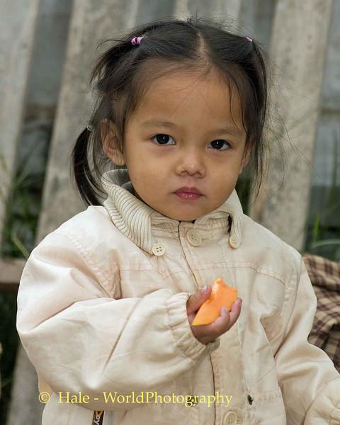 Luang Prabang Vendor's Child Eating- Laos