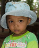 Lao Loum Young Boy with Hat- Tahsang Village, Isaan Region Thailand