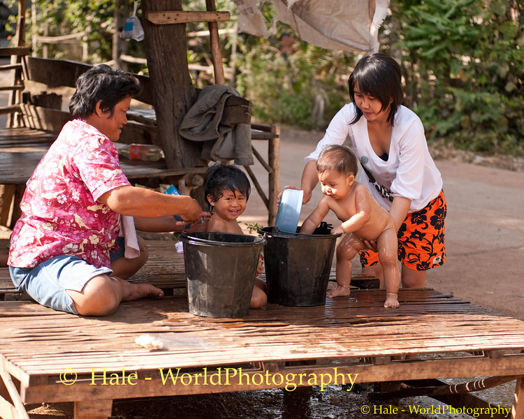 Kwan and Peelawat, Lao Loum Cousins, Having Their Baths Together in Tahsang Village Isaan