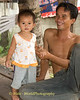 Lao Loum Infant and Her Father, Tahsang Village Isaan Region Thailand