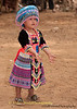 Young Hmong Girl in Traditional Clothing Prepares To Catch A Ball at New Year's Festival in Luang Prabang, Lao People's Democratic Republic