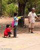 Young Girls Fire A Squirt Gun For Songkran
