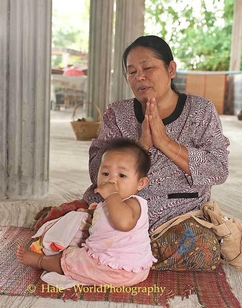 A Baby and Her Grandmother Making Merit In Tahsang Village