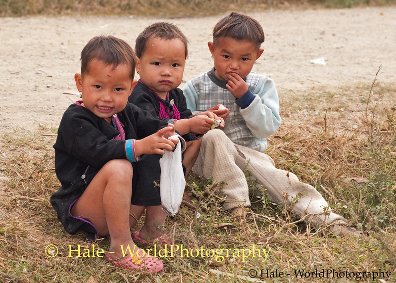 Lanten Toddlers Enjoying A Snack during Lanten New Years Festival in Ban Pakha, Laos