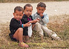 Lanten Toddlers Enjoying A Snack during Lanten New Years Festival in Ban Pakha, Laos