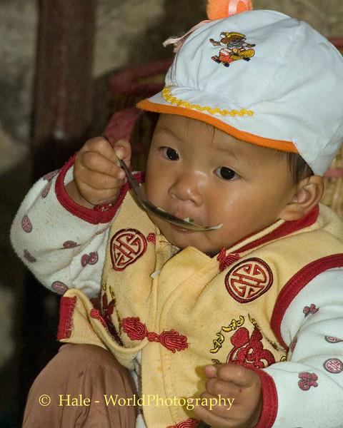 Infant Eating His Breakfast at Sapa Market, Vietnam