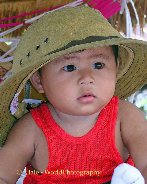 Kwan Wearing A Large Hat
