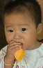 Quan Lan Island Baby Enjoying Fruit Snack, Vietnam