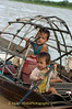 Sister Paddling with Her Brother in their Mother's Boat on Tonle Sap Lake Cambodia