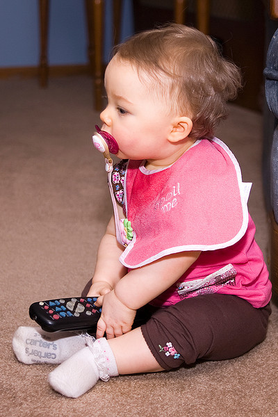 Kyrie with her remote control, minus batteries.