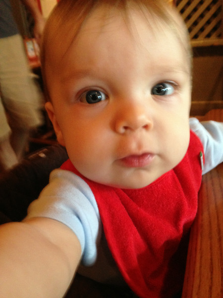 I was trying to get a picture of him in the high chair at Cracker Barrel, but he was trying to steal my phone.