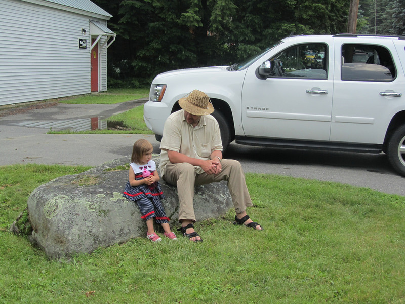 Daddy watches Skye as she watches the parade.