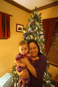Mommy and Sophie posing in front of the Christmas tree