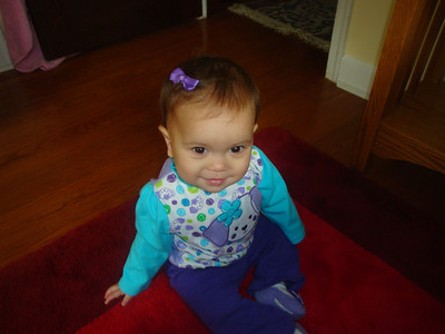 Sophie wearing a top from Grandma Aida and a purple little bow.