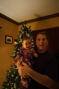 Sophie and Daddy posing in front of the Christmas tree