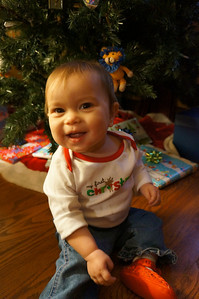 "Wearing her ""First Christmas"" onesie."