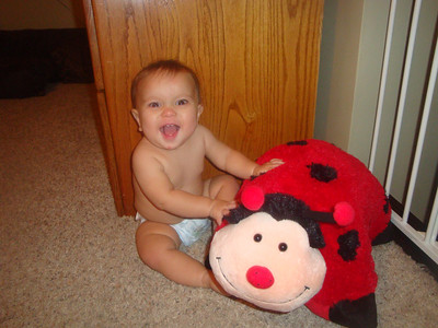 Sophie and her lady bug pillow pet from the SRM Administrative Services Staff