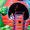 Brooke Parks, 4, peeks out of the dizzy dragon ride at the St. Bernard's Spring Carnival on Thursday afternoon during April vacation for the local schools. SENTINEL & ENTERPRISE / Ashley Green