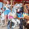 Lillian Millard, 5, rides merry-go-round at the St. Bernard's Spring Carnival on Thursday afternoon during April vacation for the local schools. SENTINEL & ENTERPRISE / Ashley Green