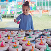 Mila Calle, 4, plays a game at the St. Bernard's Spring Carnival on Thursday afternoon during April vacation for the local schools. SENTINEL & ENTERPRISE / Ashley Green