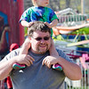 Eleanor Collins, 2, gets a lift from dad Derek at the St. Bernard's Spring Carnival on Thursday afternoon during April vacation for the local schools. SENTINEL & ENTERPRISE / Ashley Green