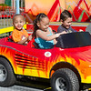 Jaden Johnson, 4, Desteny Acosta, 7, and Miguel Gutierrez, 7, ride the train at the St. Bernard's Spring Carnival on Thursday afternoon during April vacation for the local schools. SENTINEL & ENTERPRISE / Ashley Green