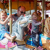 Lillian Millard, 5, John Hamilton and Haylie Hamilton, 4, ride the merry-go-round at the St. Bernard's Spring Carnival on Thursday afternoon during April vacation for the local schools. SENTINEL & ENTERPRISE / Ashley Green