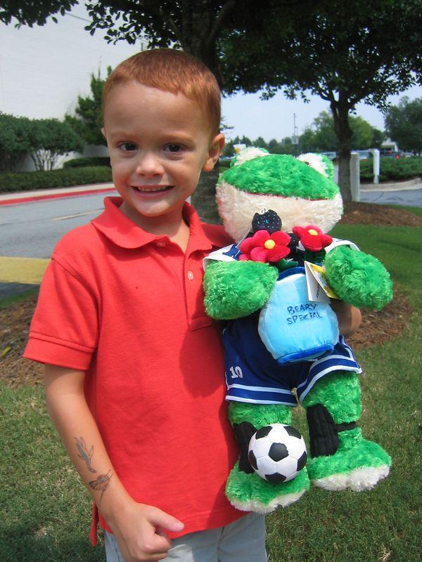 Jackson loves his new frog named Soccer Hero.