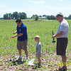 GrandDad, Daddy, and Alex preparing the rockets - the blue one went up REALLY high and got lost in the trees - oh well!