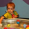 Collecting balls in the water table.