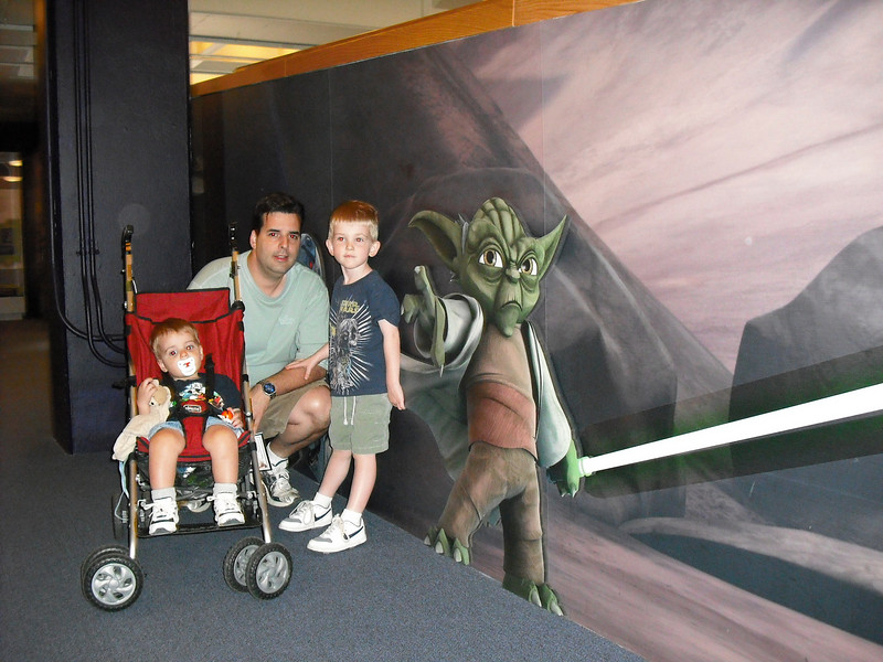 After much deliberation, Alex chose to have their photo with Yoda.