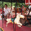 Zach enjoying the merry-go-round. He talked to the horses the whole ride. 7/3