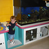 Zach trying to poop while looking at the fish.