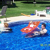 Zach deciding whether or not to come in and Alex enjoying the raft.